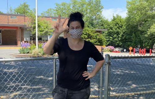 Staff member outside wearing a black shirt.