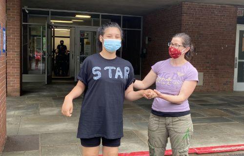 Student wearing a star shirt.