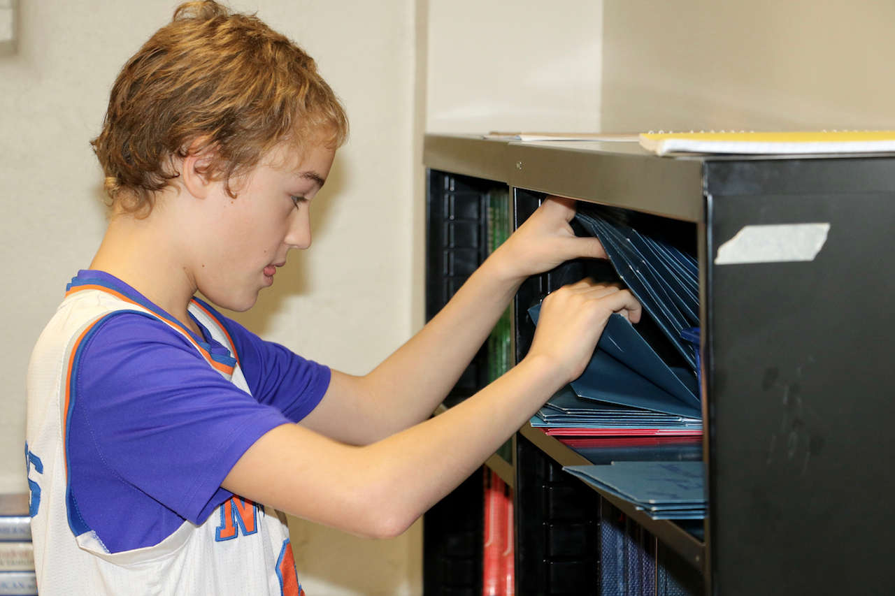 student at a filing cabinet