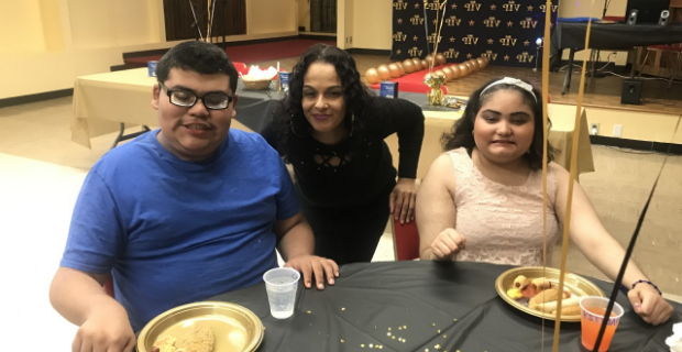 Three people smiling at the luncheon table