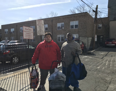 students walking with donations to Soup Kitchen