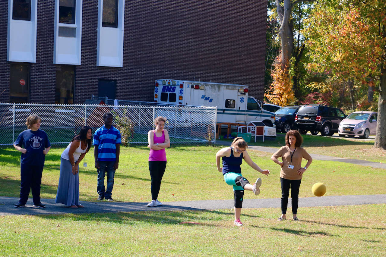 students playing kickball on the quad