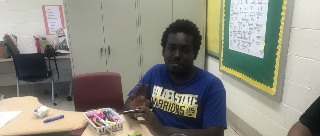 Student working in art class using markers
