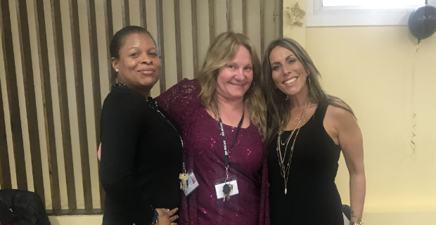 Three staff members at the prom