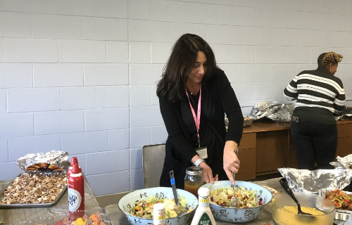 Staff at the feast mixing the salad