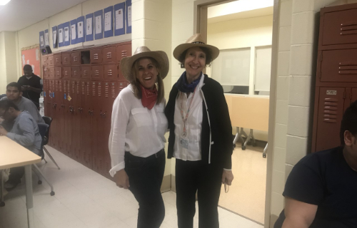 Two staff dressed as cowgirls