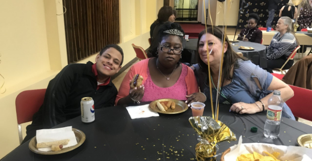 Student and staff hanging together at the table