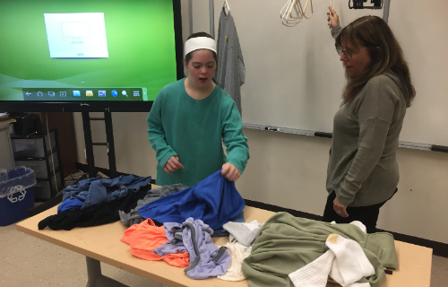 Student working with the shirts