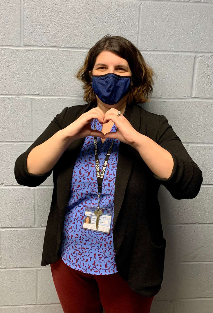 Principal making a heart with her  hands