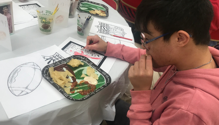 Student eating a big dish of food