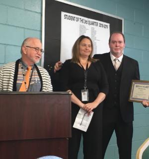 Staff giving an award