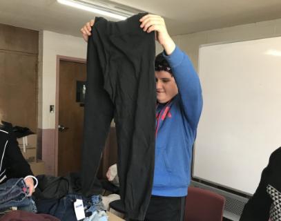 Student holding clothing