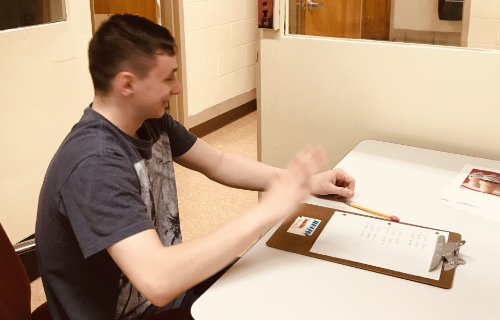 Student taking inventory with clipboard