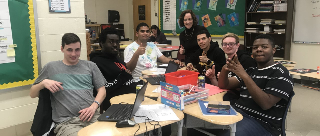 Students and staff celebrating their work at their desks