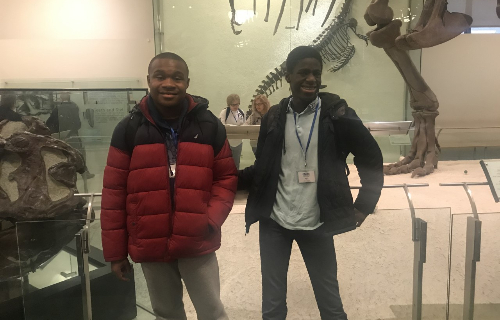 Students and staff posing together at the  Museum of Natural History