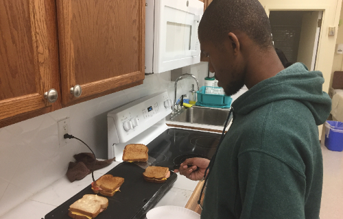 Student making grilled cheese