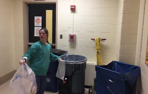 Student collecting and removing the trash