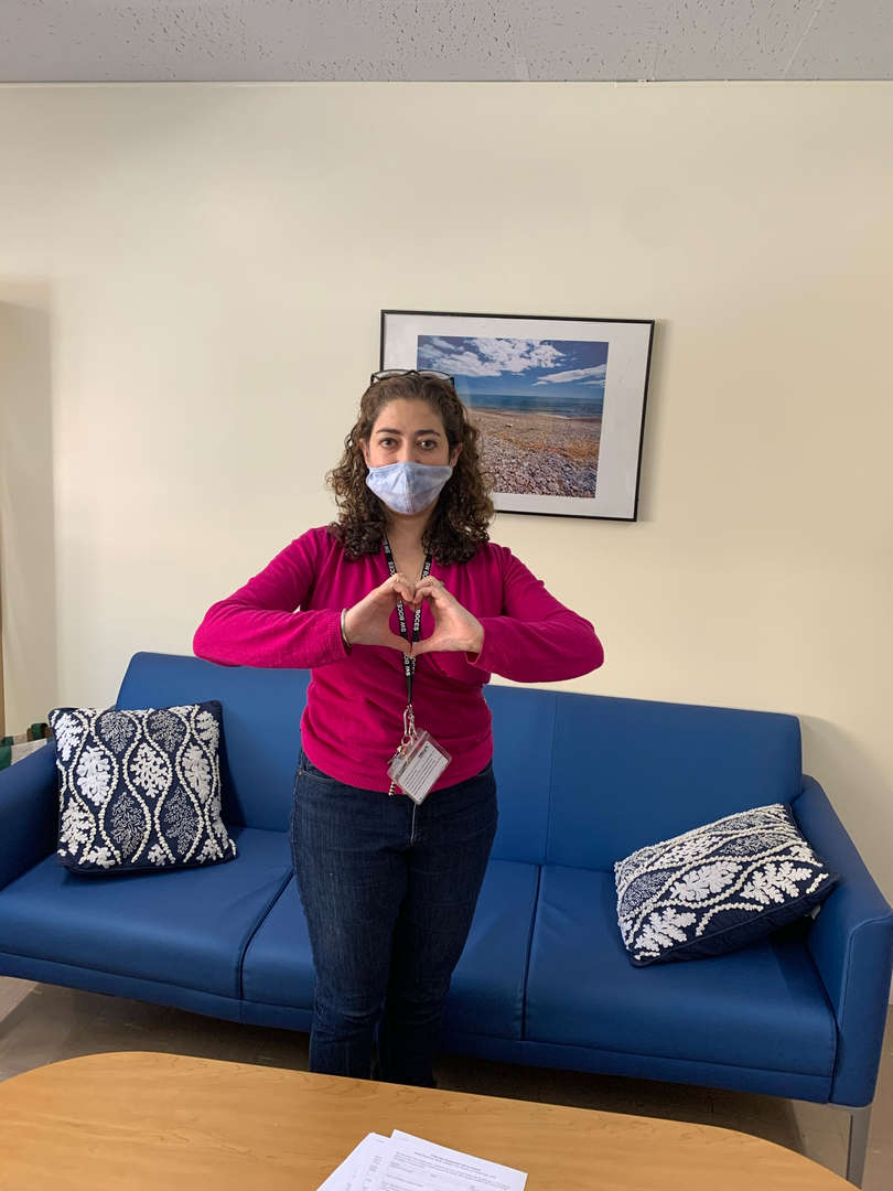 Social worker making a heart with their hands