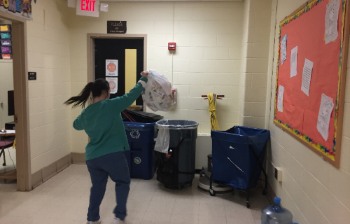 Student throwing away the trash