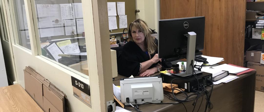 Staff sitting at her desk