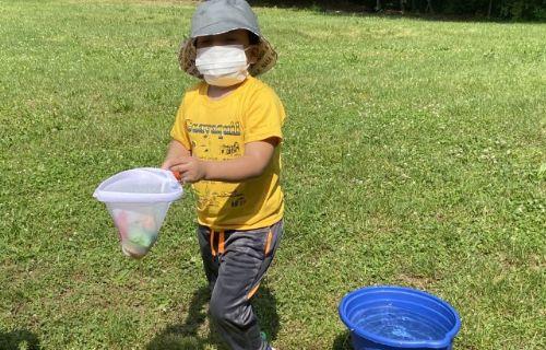 Student in yellow shirt fishing.