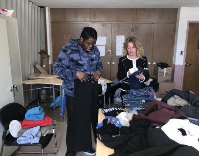 Student and staff organizing clothing