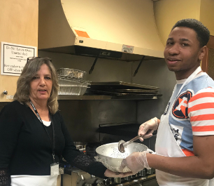 Student and staff cooking
