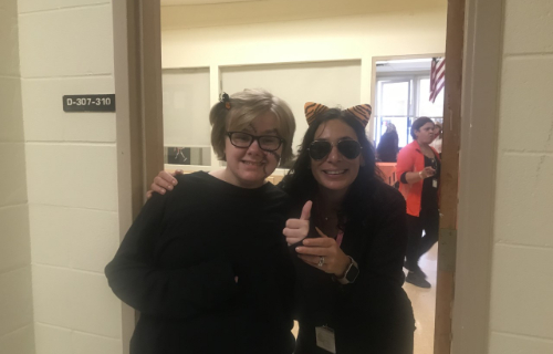 Staff dressed as a kitty and student smiling