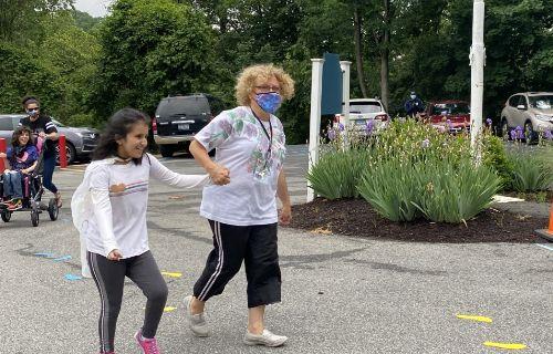 Staff and student running.
