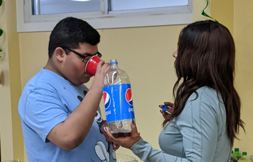 Nurse serving student a soda