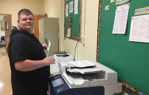Student working the copy machine