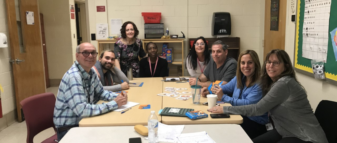 Staff playing cards to learn how people think differently