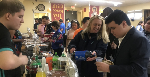 Student and staff getting drinks