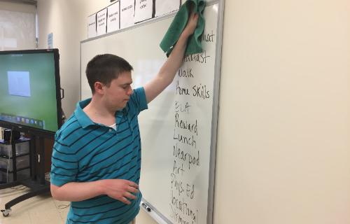 Student erasing the white board