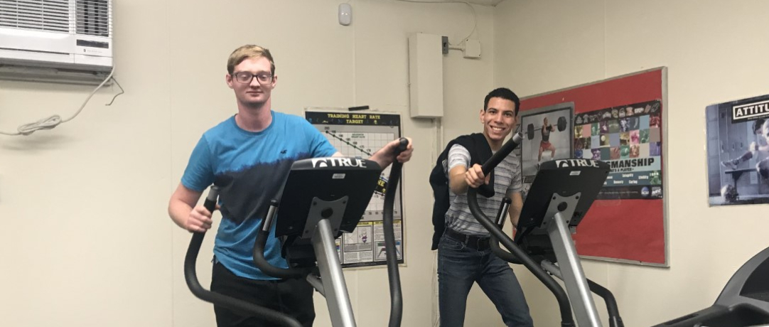 Students in Gym working out on the elliptical