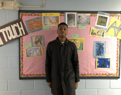 Student in front of bulletin board