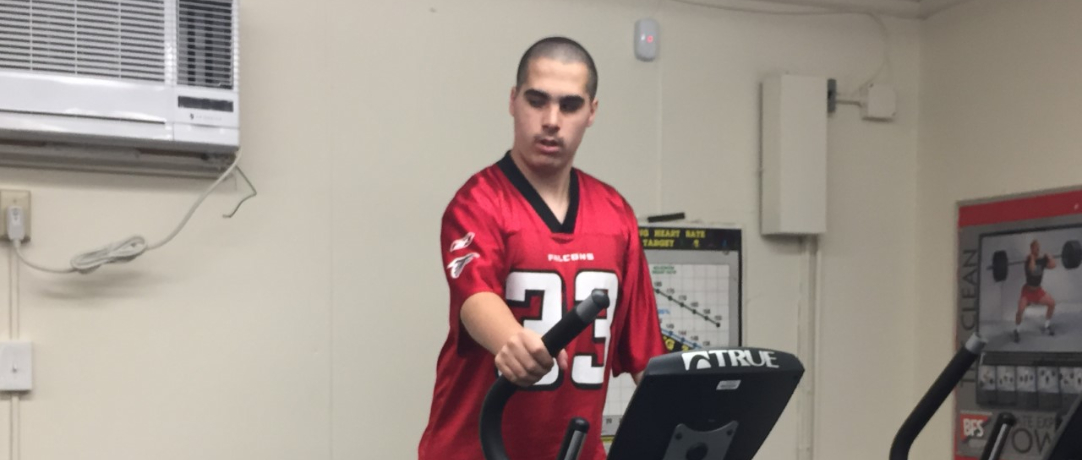 Student on elliptical in gym