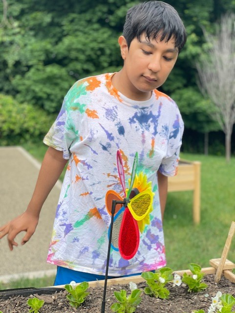 Student wearing a colorful shirt on field day.