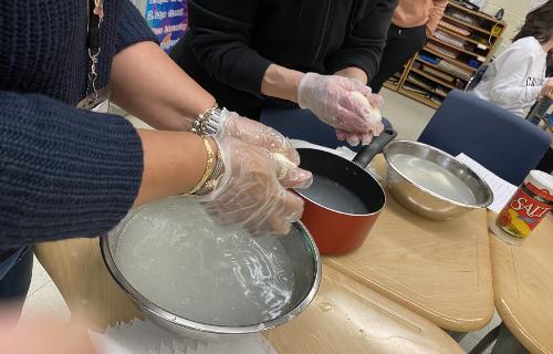 Rolling the mozzarella curd