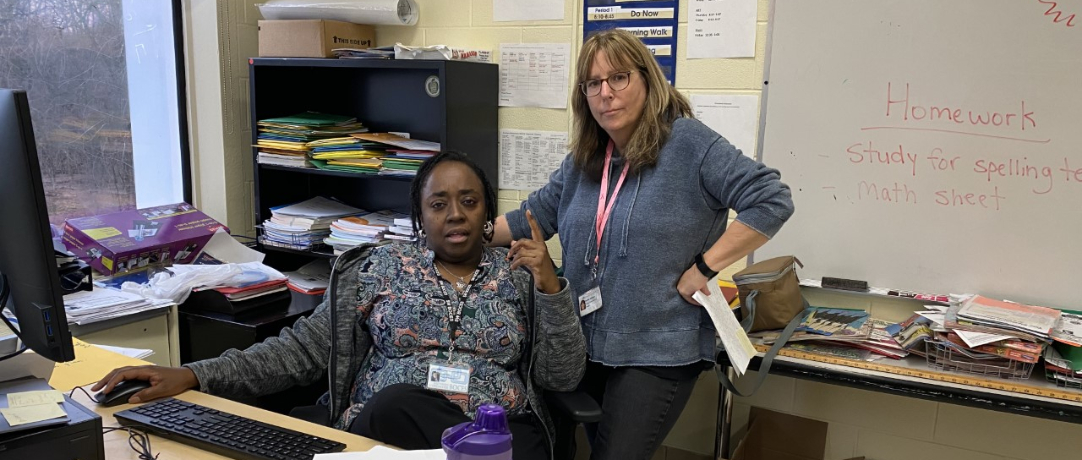 Two teachers at the desk
