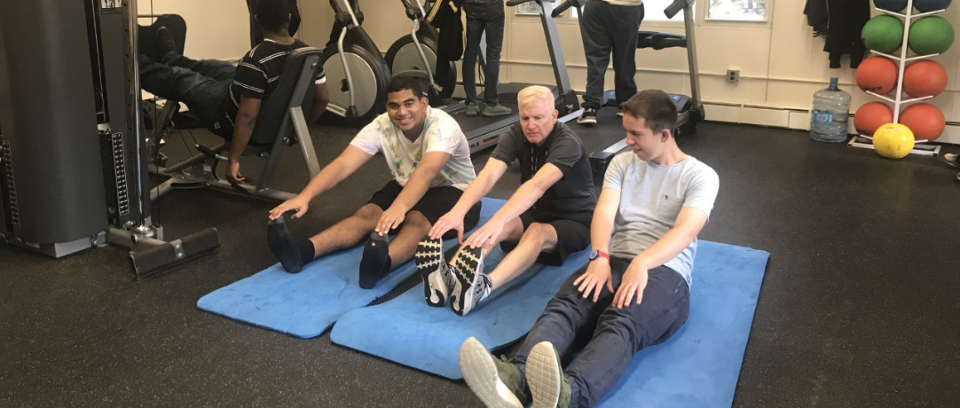 Students and staff working out