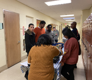 Students and staff working at the school's snack store