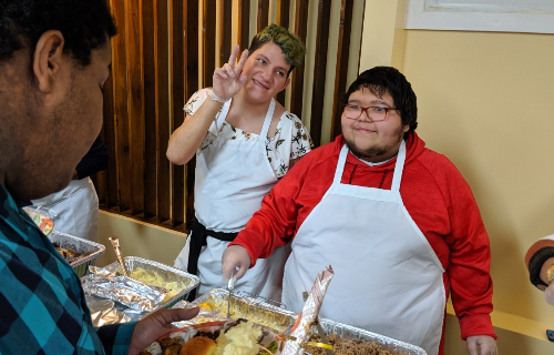 Two students serving food