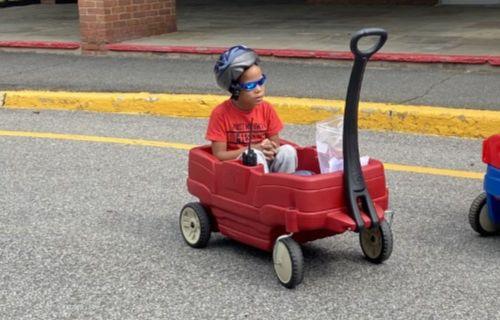 Boy in wagon.