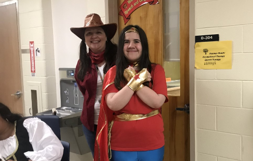 Student dressed as wonder-woman and staff