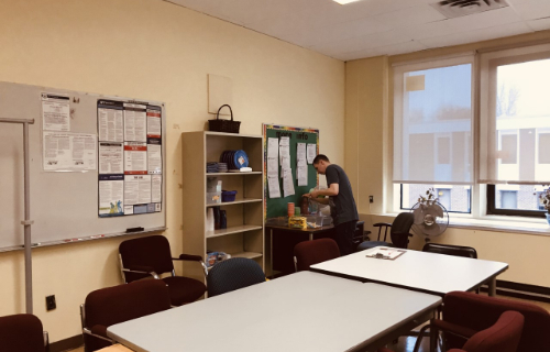 Extended room view with student at desk