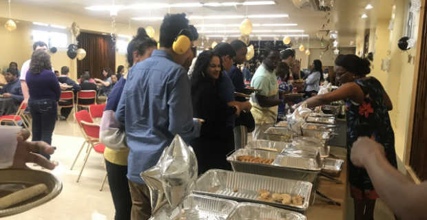 Student and staff getting food