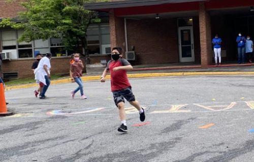 Student running around the turn.