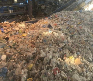 Huge mounds of recycled materials in piles at the Recovery Facility Center