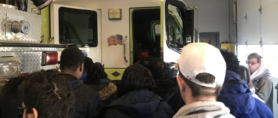 Fire truck and students looking at the special features